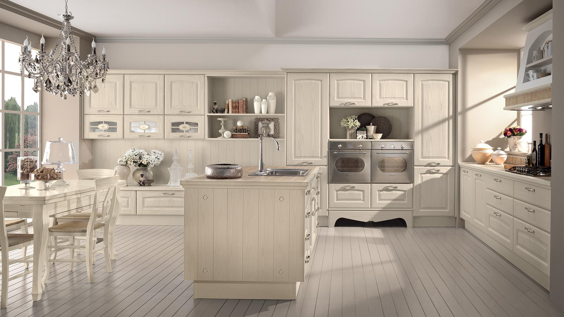 Cucina rustica le soluzioni classiche di lube store per - Cucine classiche con isola ...